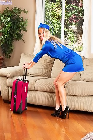 Bella Bends: Flight attendant MILF blonde showing her perfect pussy on a couch